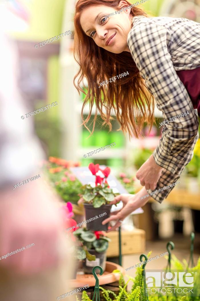 Stock Photo: Woman working at garden centre.