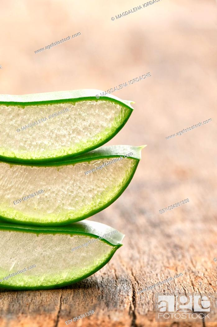 Stock Photo: Slices Of Aloe Vera Leaves on Wooden Table.