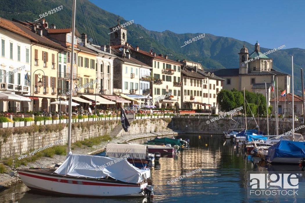 Stock Photo: Italy, Piedmont, Lake Maggiore, Cannobio, Piazza Vittorio Emanuele III buildings and harbor, morning.