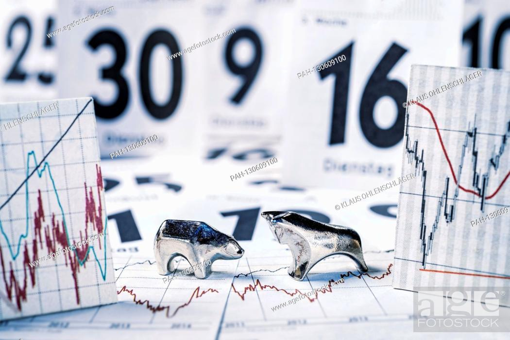 Stock Photo: Bull and bear, charts with stock prices and calendar sheets | usage worldwide.