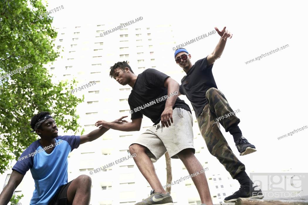 Stock Photo: Young men in park. Frankfurt am Main, Germany.