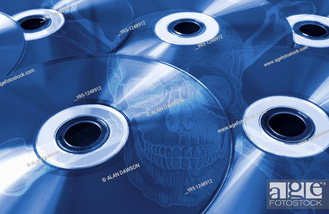 Stock Photo: Compact discs with skull and crossbones overlayed  Concept image depicting pirate CD's.