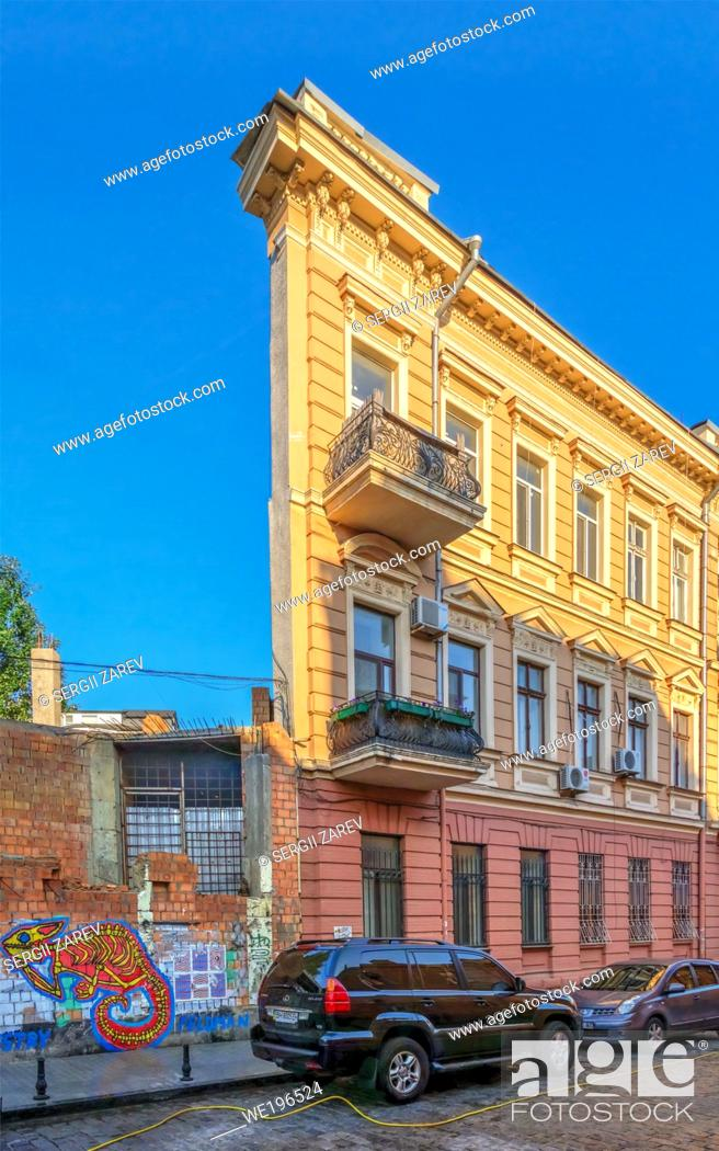 Stock Photo: Odessa, Ukraine 06. 30. 2020. House with one wall in the historical center of Odessa, Ukraine, on a sunny summer morning.