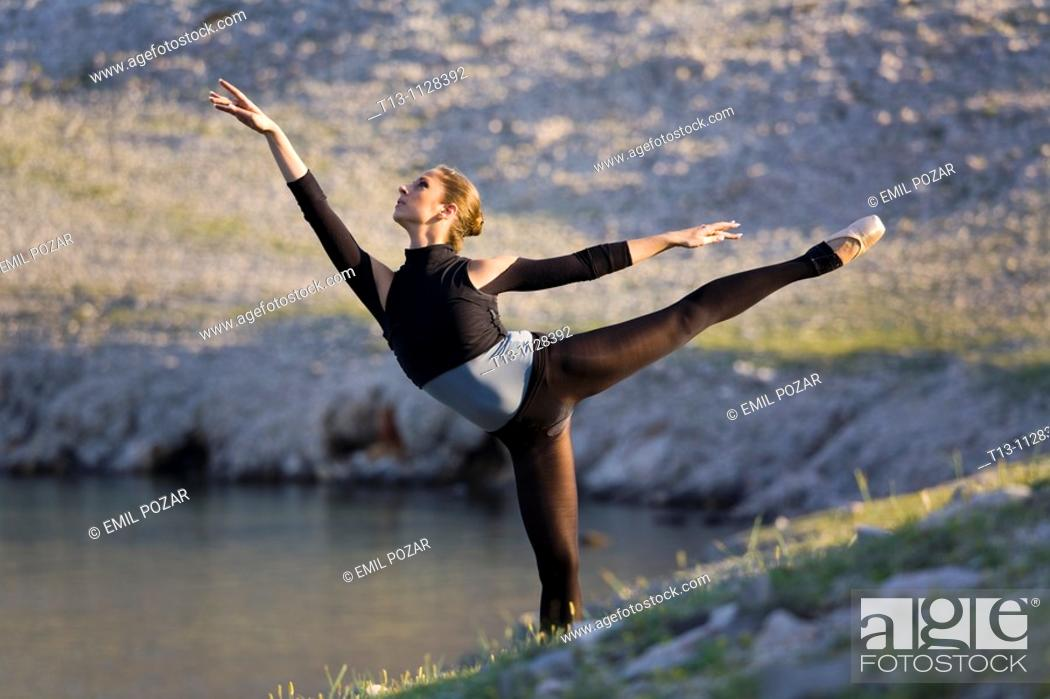 Stock Photo: Ballerina dancing in a natural environment.