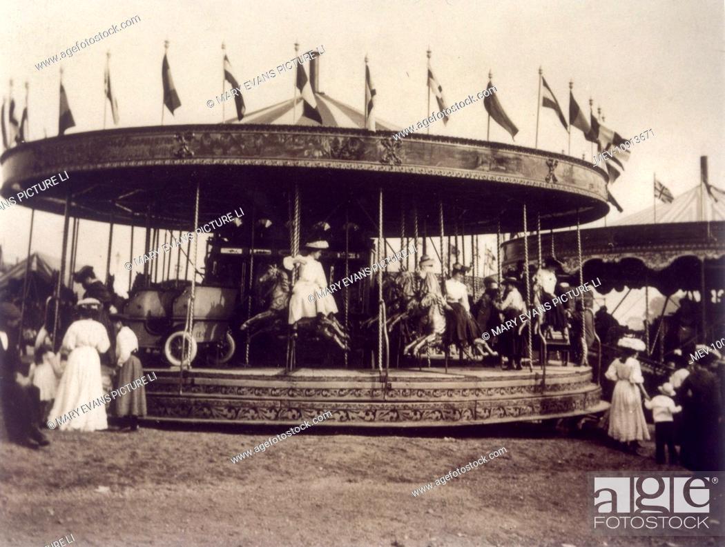 Stock Photo: Three-abreast set of steam-driven 'gallopers', Hampstead Heath Fair, London.