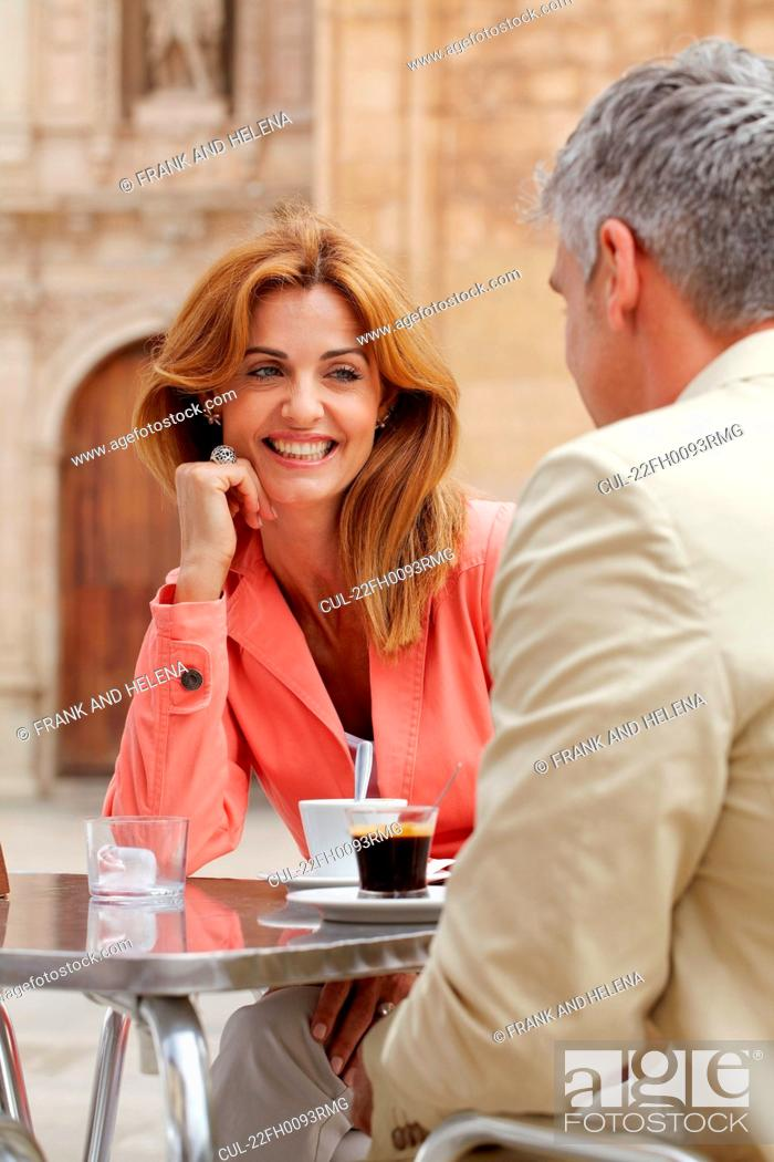 Stock Photo: Smiling woman with coffee in cafe.