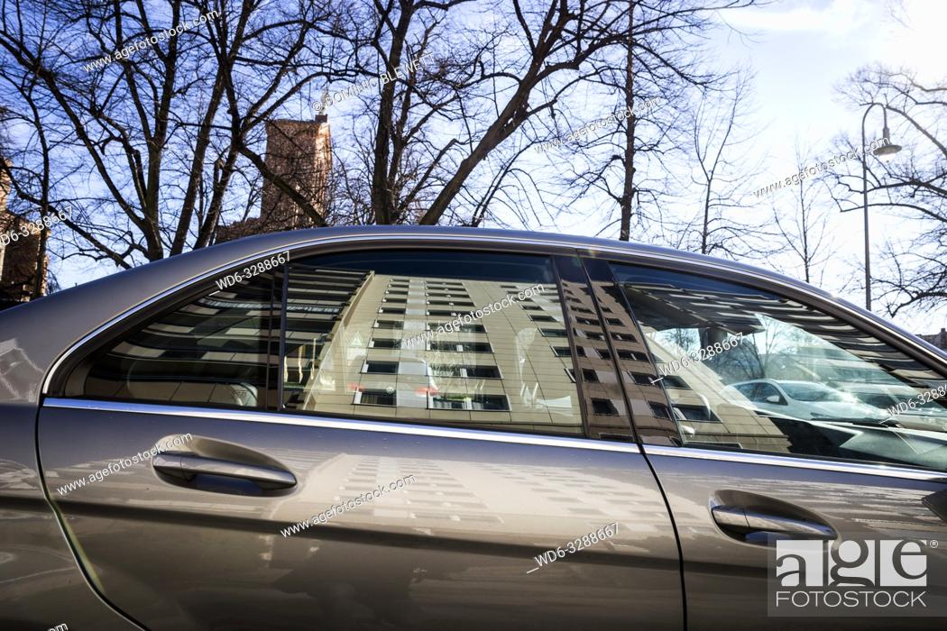 Photo de stock: A high-rise apartment block reflected in a car window in Berlin, Germany.