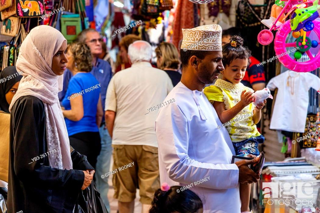 An Omani Family Shopping In The Muttrah Souk (Al Dhalam