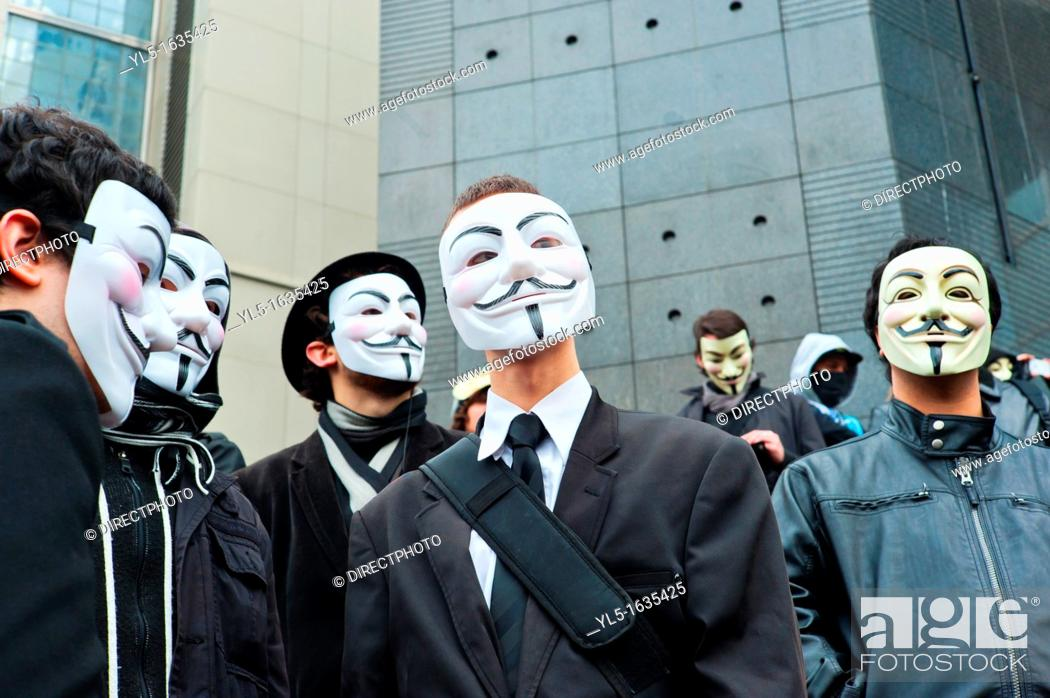 Stock Photo: Anonymous Protest Against Internet Anti-Piracy Law, ACTA (Anti-Counterfeiting Trade Agreement), that threatens freedom of the Internet, Paris, France,.