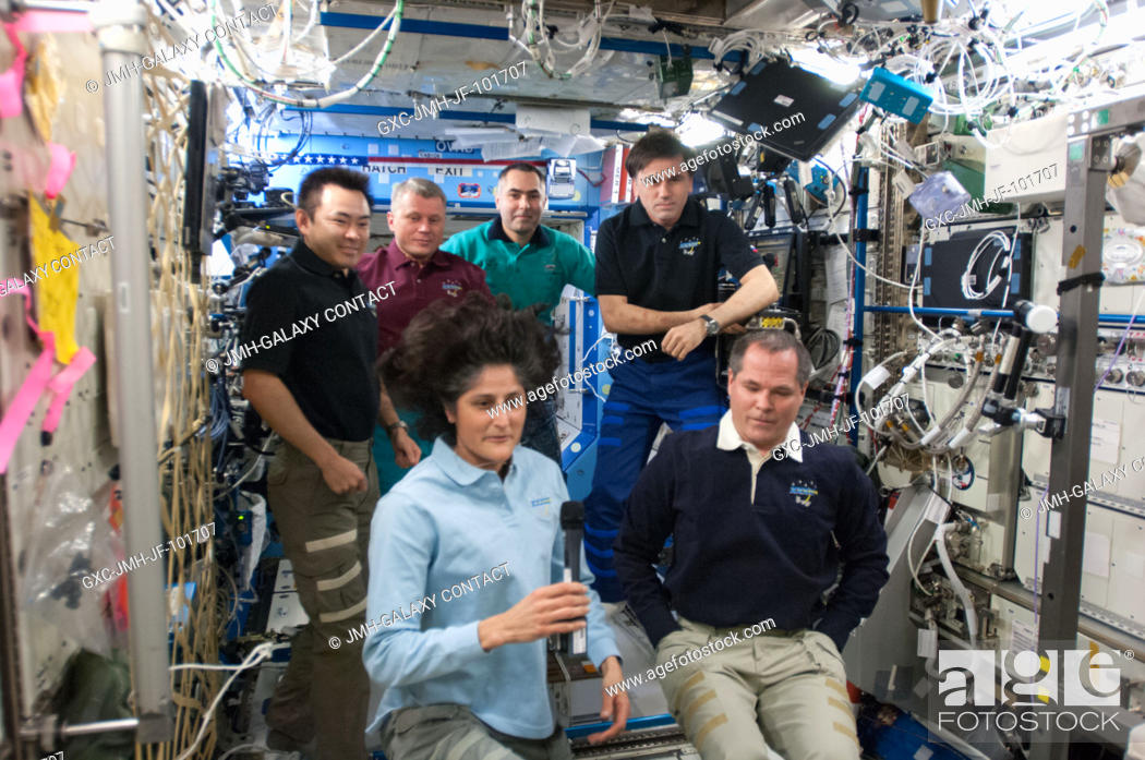 Stock Photo: Expedition 3233 and Expedition 3334 crew members are pictured in the International Space Station's Destiny laboratory during the ceremony of Changing-of-Command.