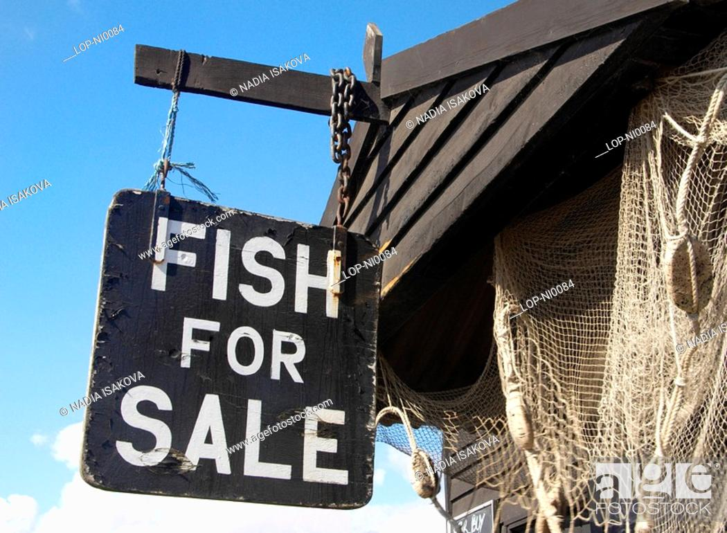 Stock Photo: England, Suffolk, Southwold, Signage on a fish stall on Southwold beach.
