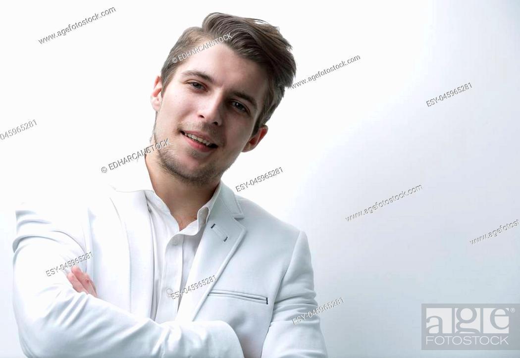 Photo de stock: confident young businessman in white shirt.