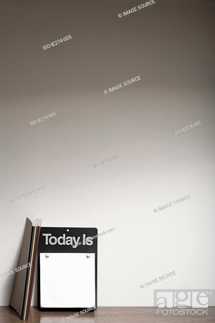 Stock Photo: Sign and notebooks.