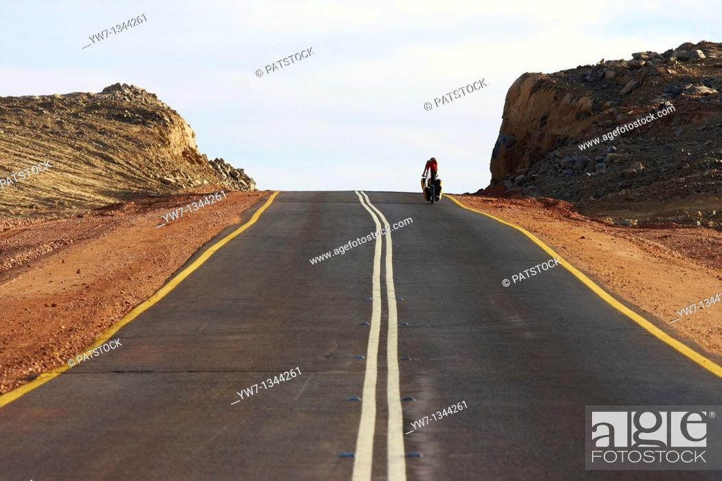 Stock Photo: A biker on the road leading to Khartoom in Sudan.