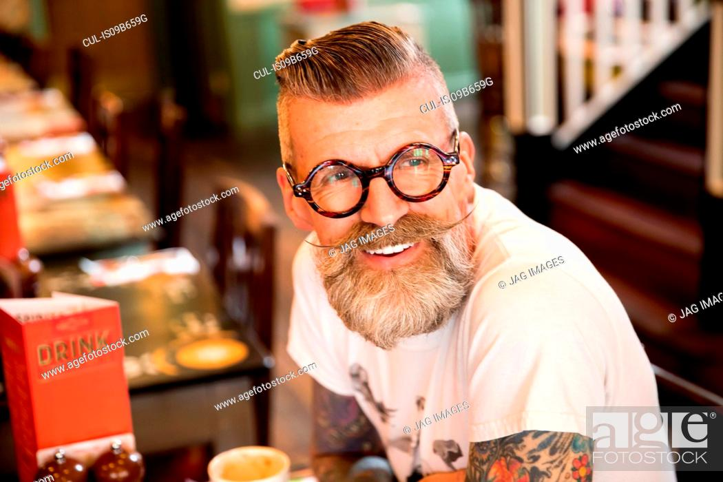 Stock Photo: Quirky man in bar and restaurant, Bournemouth, England.