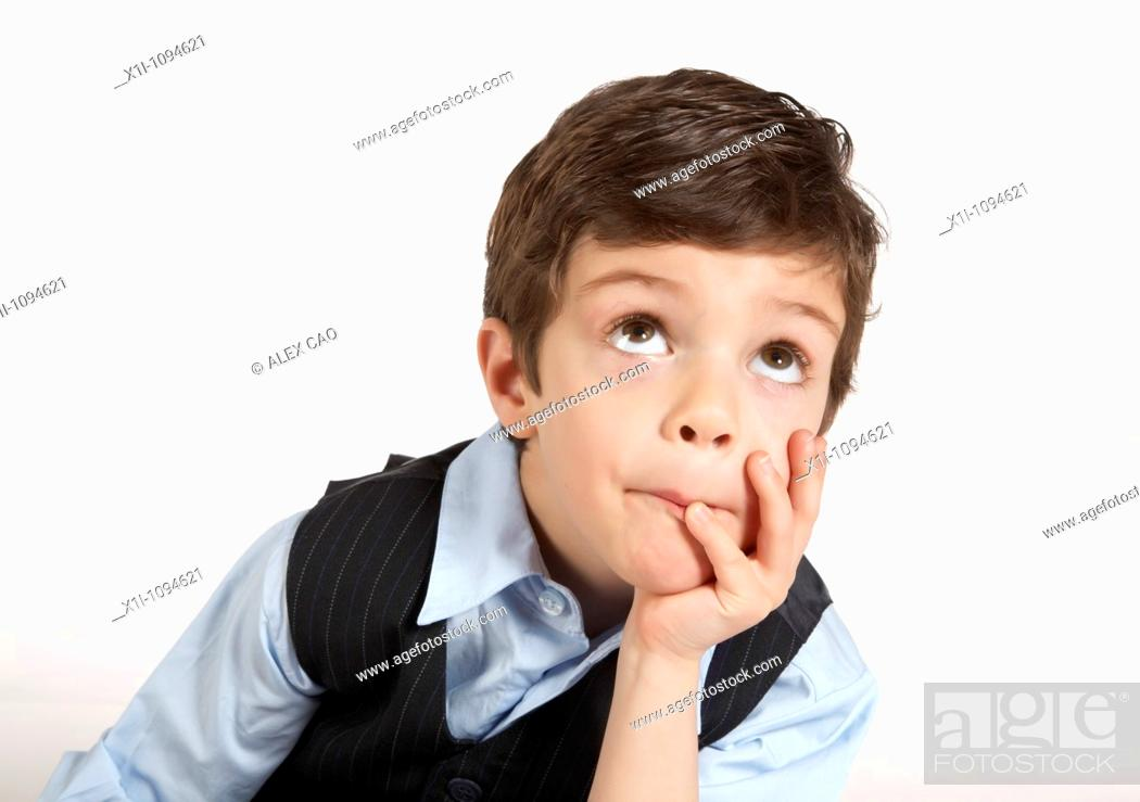 Stock Photo: Young boy with hand on chin.