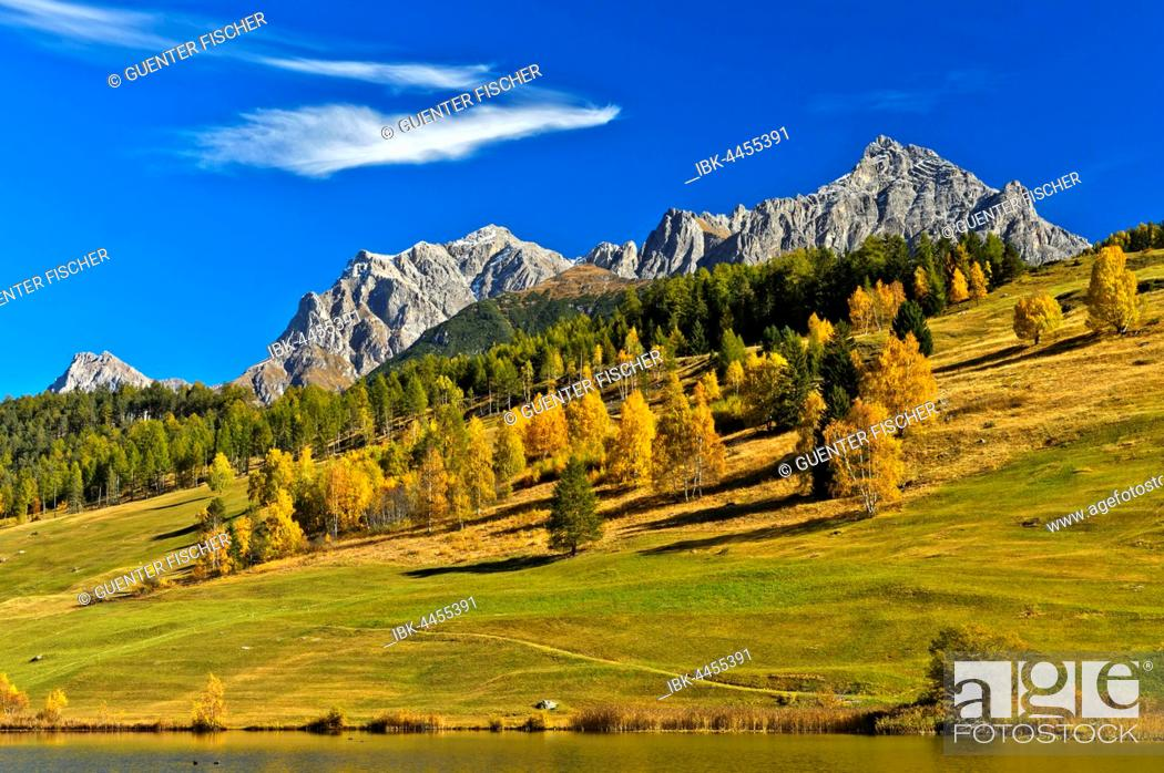 Stock Photo: Lai da Tarasp, lake with mountain landscape in autumn, Tarasp, Engadin, Grisons, Switzerland.