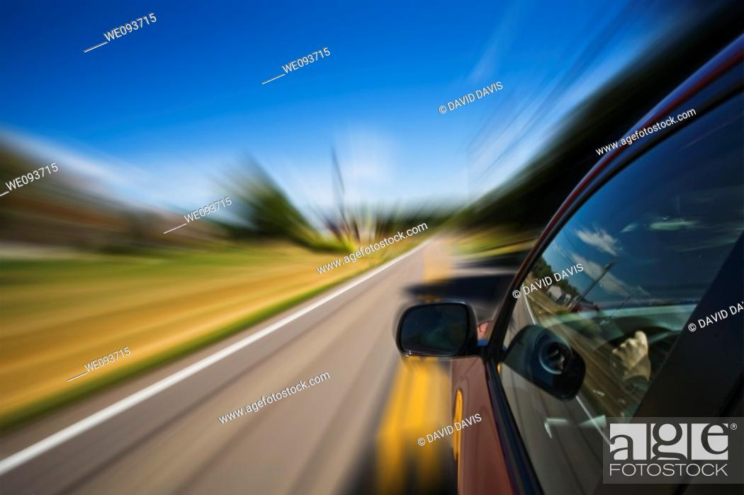 Stock Photo: Automobile driving down road with a blured affect.