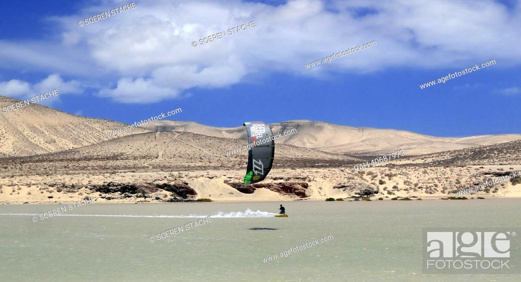 Stock Photo: A kitesurfer in action off the sandy beach of Sotavento near Costa Calma on Fuerteventura, Spain, 05 June 2013. Photo:Soeren Stache   usage worldwide.
