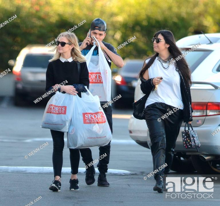 Ashlee Simpson and husband Evan Ross laden with shopping