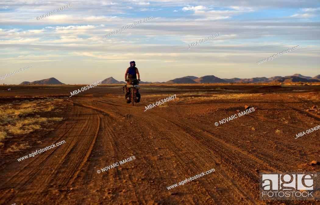 Stock Photo: Cycling in the Adrar region of the Sahara desert, Mauritania.