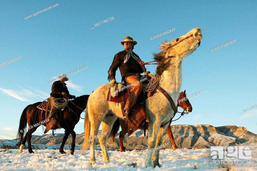 Stock Photo: Cowboys out for a ride in winter, Shell, Wyoming, USA.