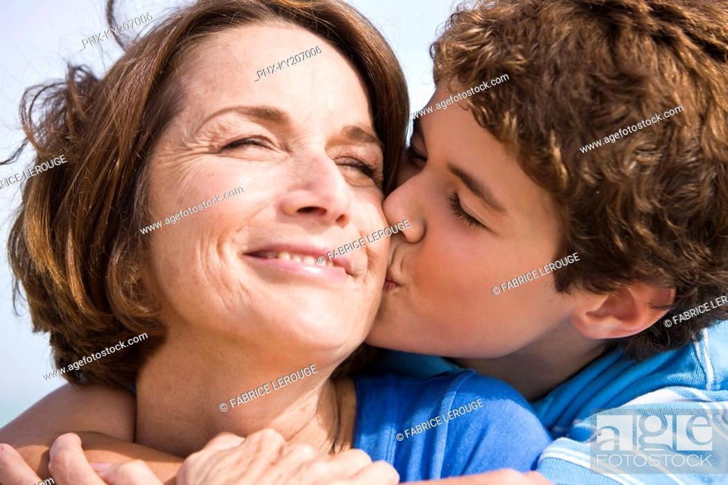 Stock Photo: Boy kissing his grandmother.