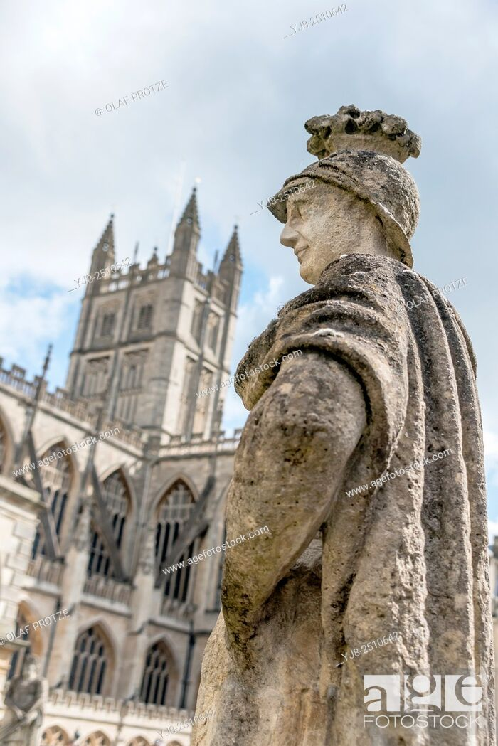 Stock Photo: Sculpture of Ostorius Scapula at the Roman Baths complex; a site of historical interest in the English city of Bath, with the Bath Abbey in the background.