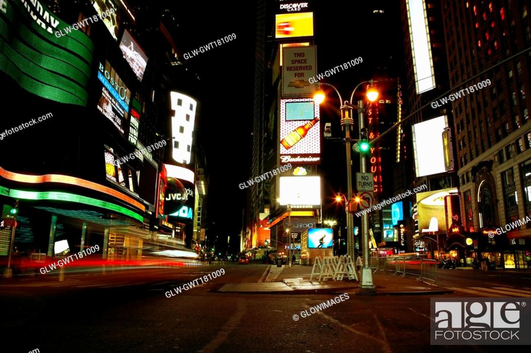 Stock Photo: Buildings lit up at night in a city, Times Square, Manhattan, New York City, New York State, USA.