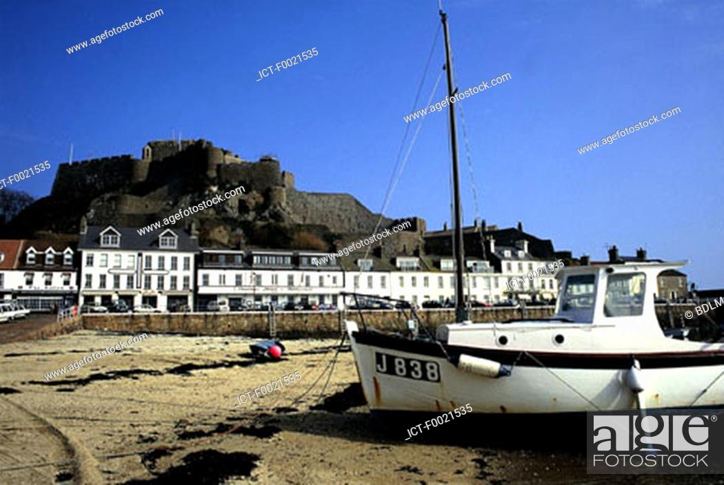 Stock Photo: Channel Islands, Jersey, boat on the beach.