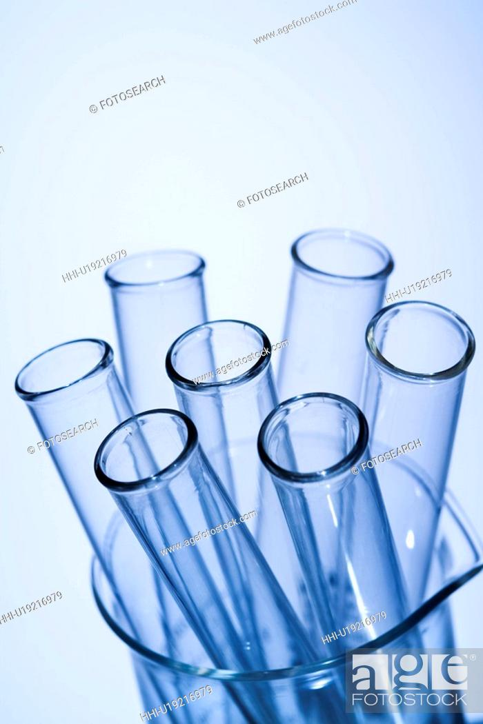 Stock Photo: Test tubes in glass beaker with blue tint.