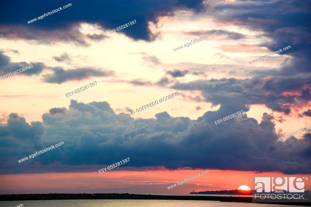 Stock Photo: background sunset on the sea in Italy.