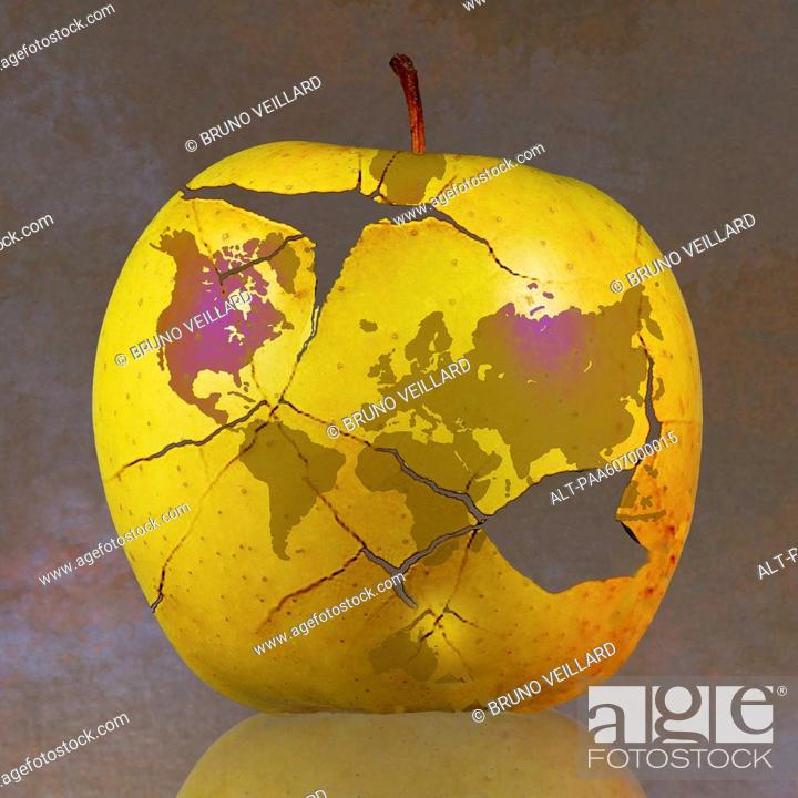 Stock Photo: World map on fractured apple.