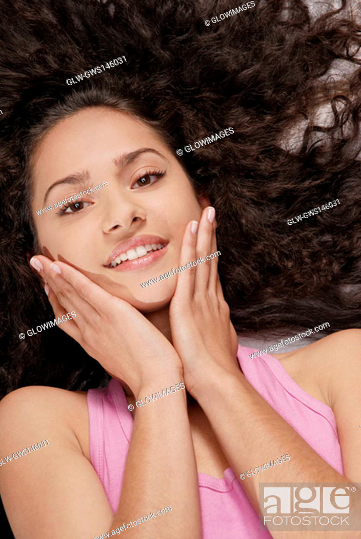 Stock Photo: Portrait of a young woman lying down.