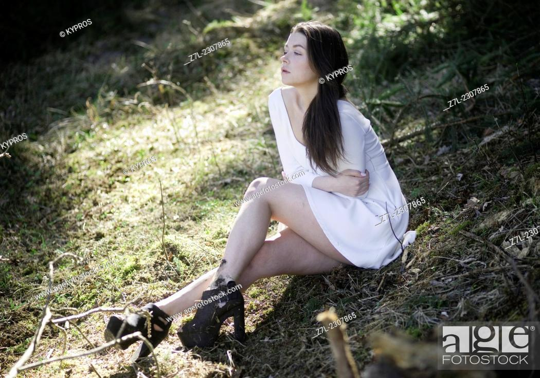 Stock Photo: Germany, Young woman on grass.