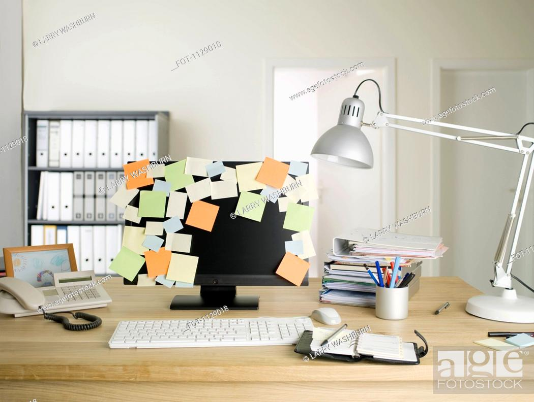 Stock Photo: A desktop PC with blank adhesive notes all over the monitor.