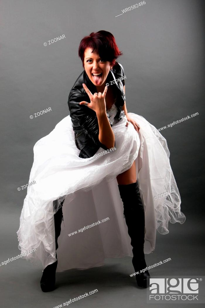 f4f5751f9b8 punk bride in a white dress and a black leather jacket with a gray ...