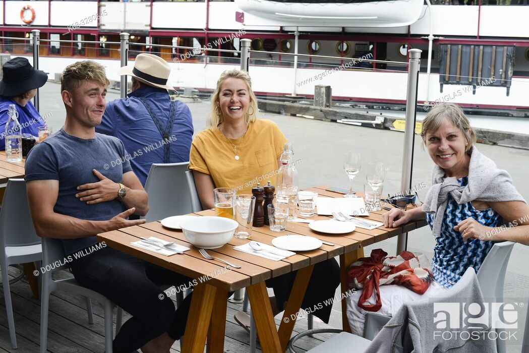 Stock Photo: People at a restaurant in Queenstown, South Island, New Zealand.