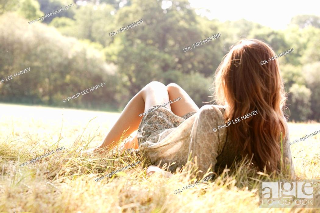 Stock Photo: Woman lying in countryside field.