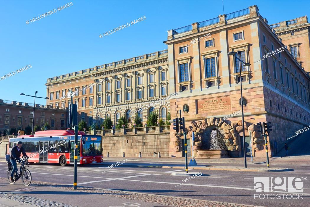 Stock Photo: Bus and cyclist passing the Royal Palace (Kungliga Slottet) Gamla Stan, Stockholm, Sweden, Scandinavia.