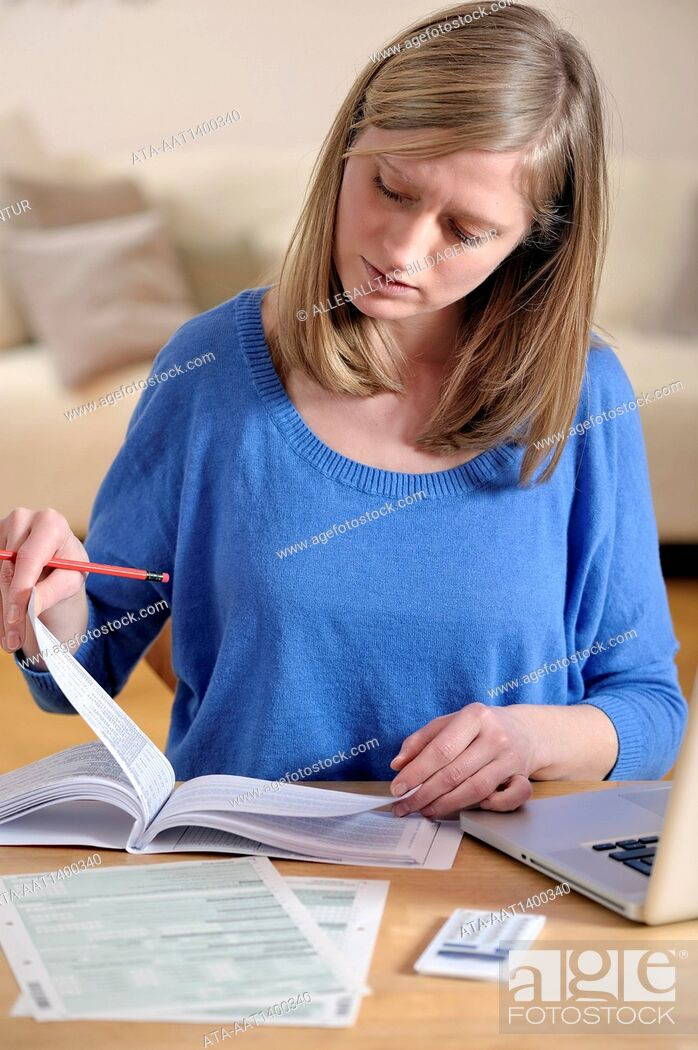 Stock Photo: Woman is doing her annual tax declaration.