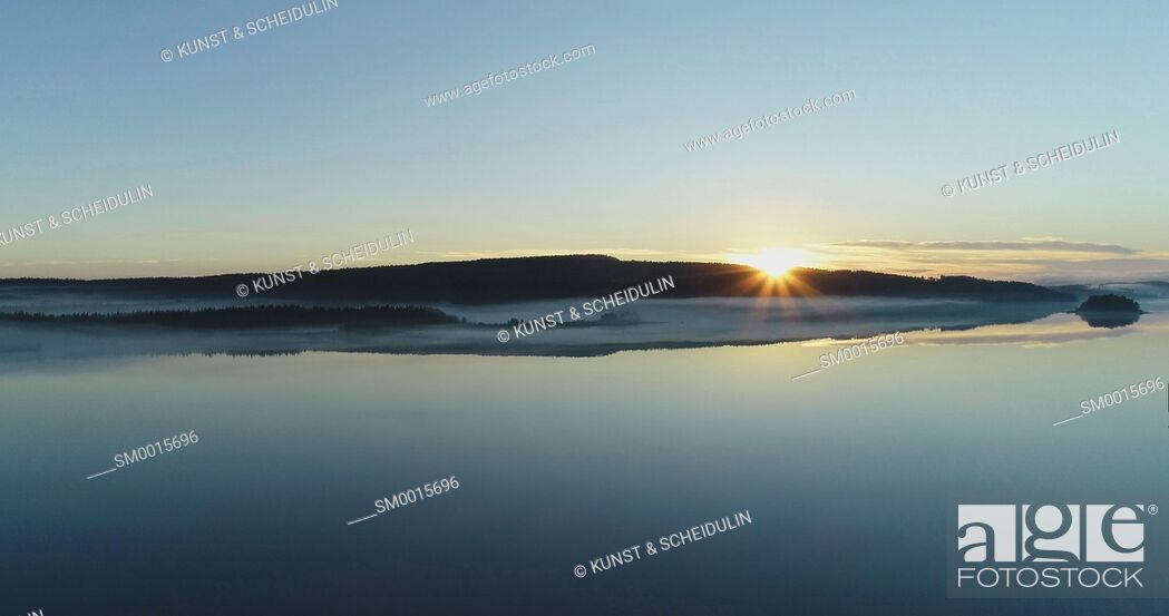 Stock Photo: Sunrise at a quiet lake in northern Sweden - aerial shot.