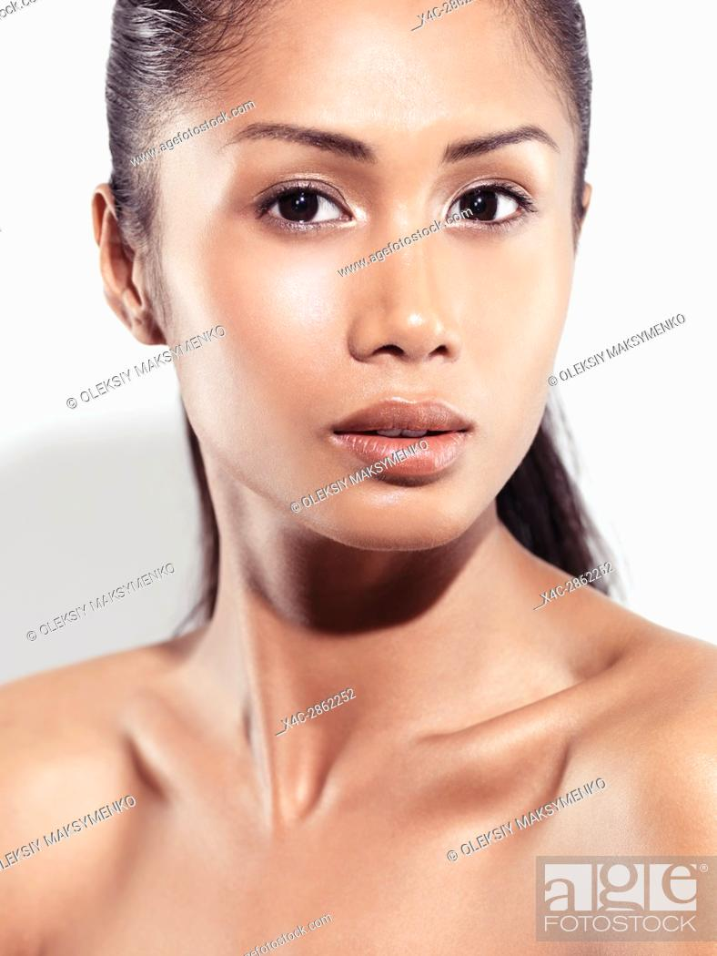 Stock Photo: Sensual closeup beauty portrait of a young woman beautiful exotic face pacific islander with healthy natural look isolated on white background.