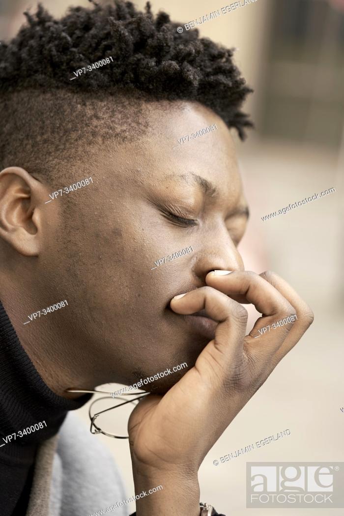 Imagen: African man enjoying inner feelings.