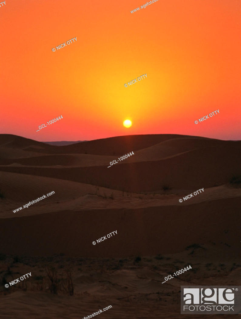 Stock Photo: Orange sky at sunset over the desert.