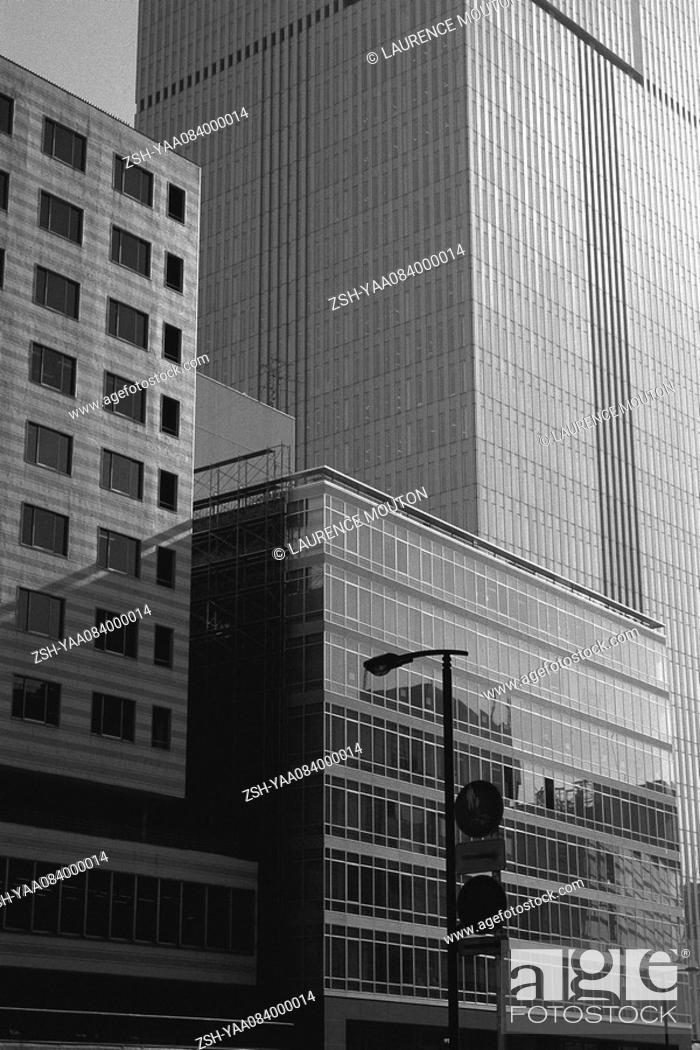Stock Photo: Office buildings rising side by side.