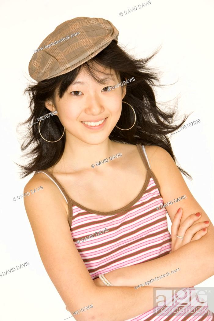 Stock Photo: Portrait of a beautiful Asian teenager on a white background.