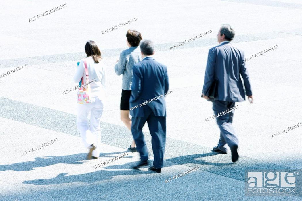 Stock Photo: Pedestrians walking across public square.
