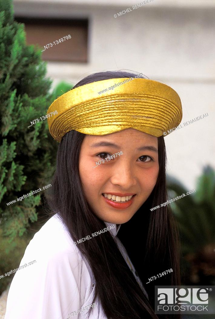 Stock Photo: Vietnam, Hue, a young woman in traditional ceremonial dress.