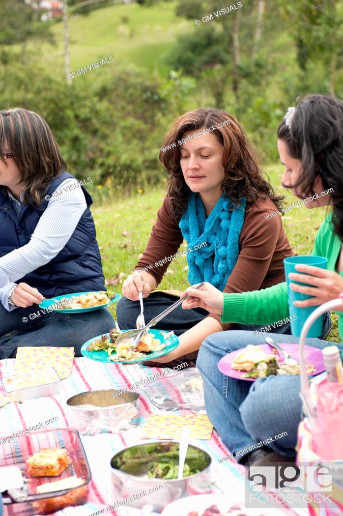 Stock Photo: Hispanic woman enjoying picnic.